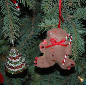 "The tree was a Grandma creation - the fabulous gingerbread man was made by my niece, years ago.  My five year old daughter said, ""This is kind of a weird ornament."" I said, ""I love it.  Hang it up."""